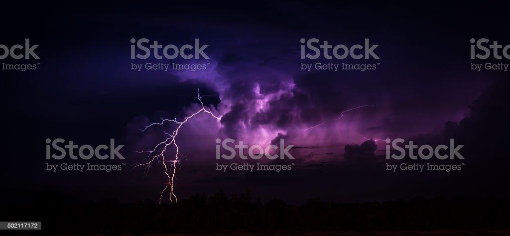 Lightning in the big cumulonimbus cloud stock photo