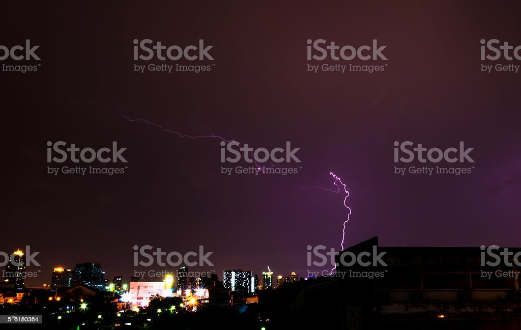 Lightning in the city at night. stock photo