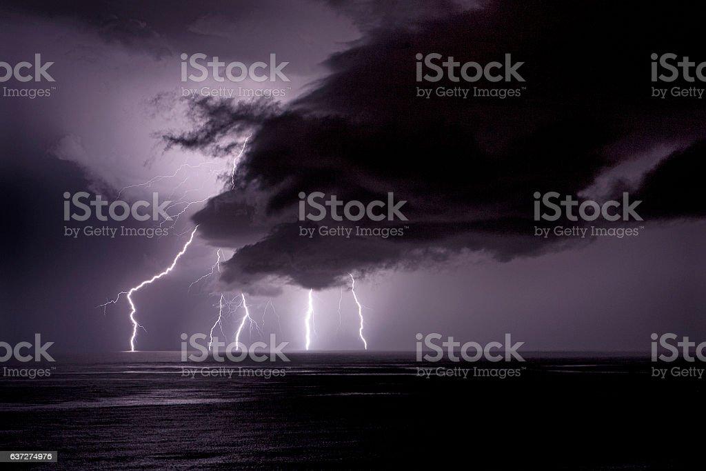 Lightning in the ocean stock photo