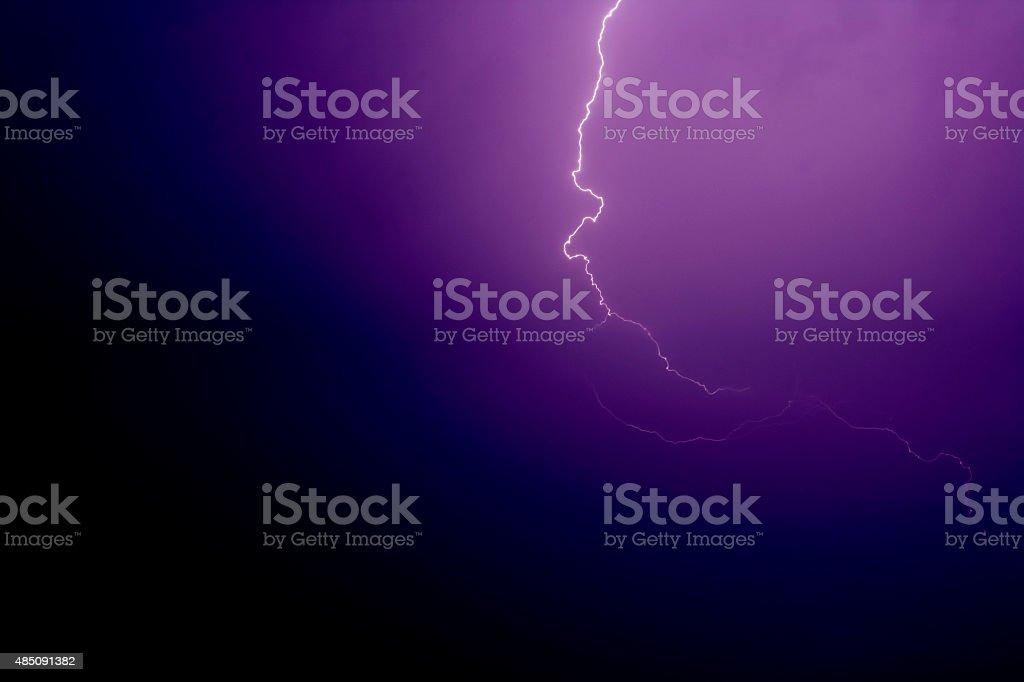 Lightning on a purple sky background stock photo