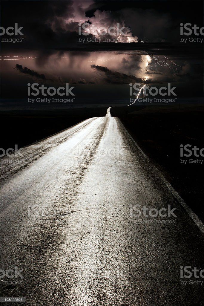 Lightning On Lone Road at Night royalty-free stock photo