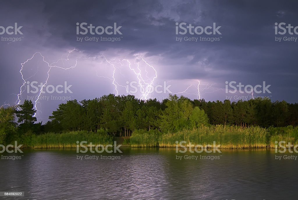 Lightning on the river. stock photo