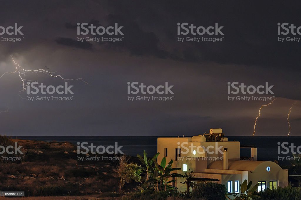 Lightning over beach house royalty-free stock photo