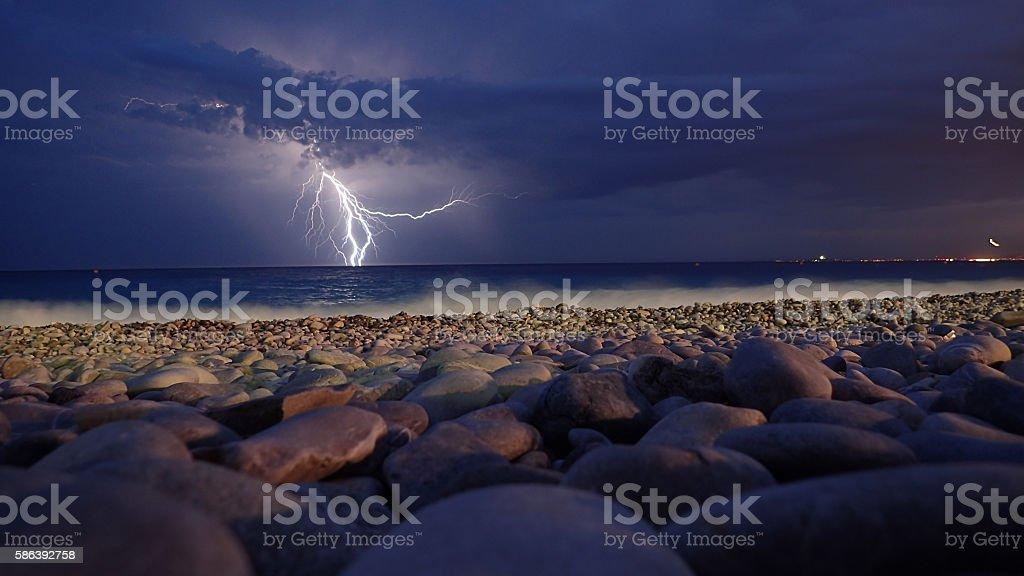 Lightning over sea on Nice beach stock photo