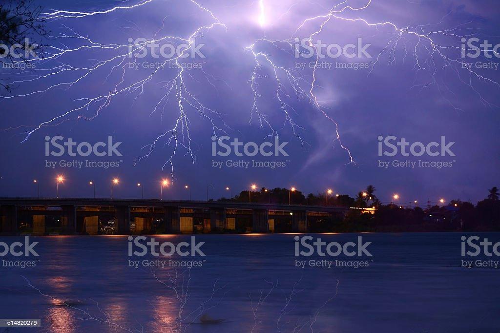 Lightning over the bridge stock photo