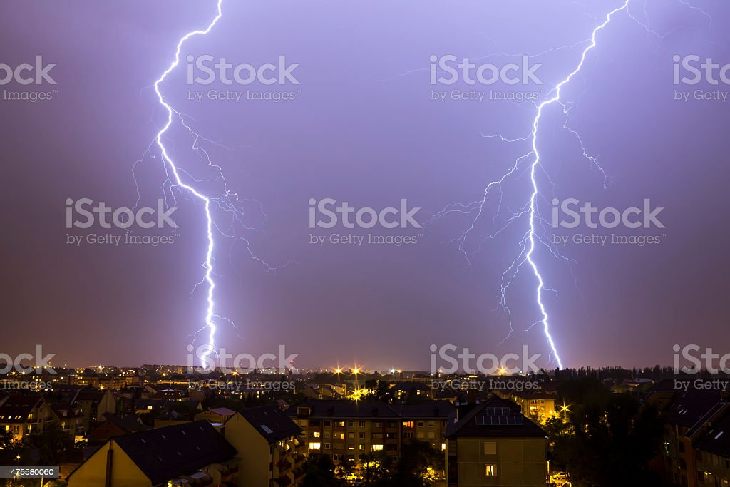 Lightning over the city stock photo