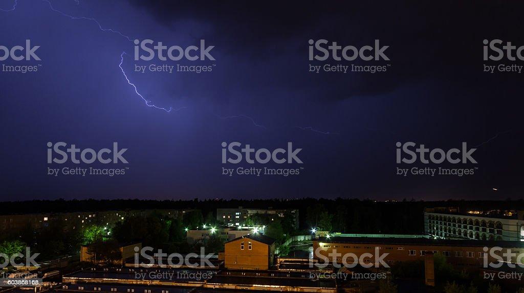 Lightning over the dark sky in the city stock photo