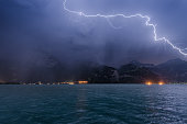 Lightning over the mountains and lake