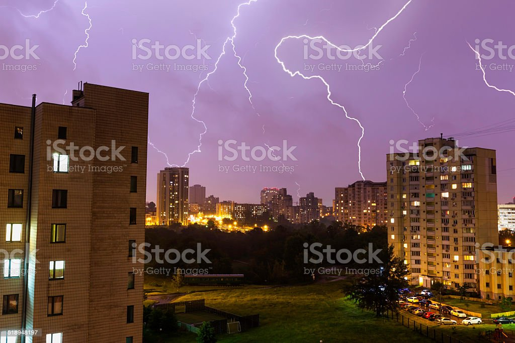 Lightning over the night city stock photo