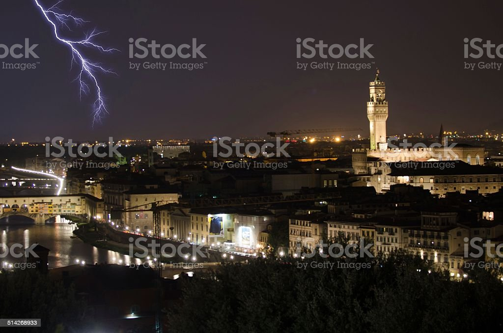 Lightning over the Ponte Vecchio in Florence stock photo