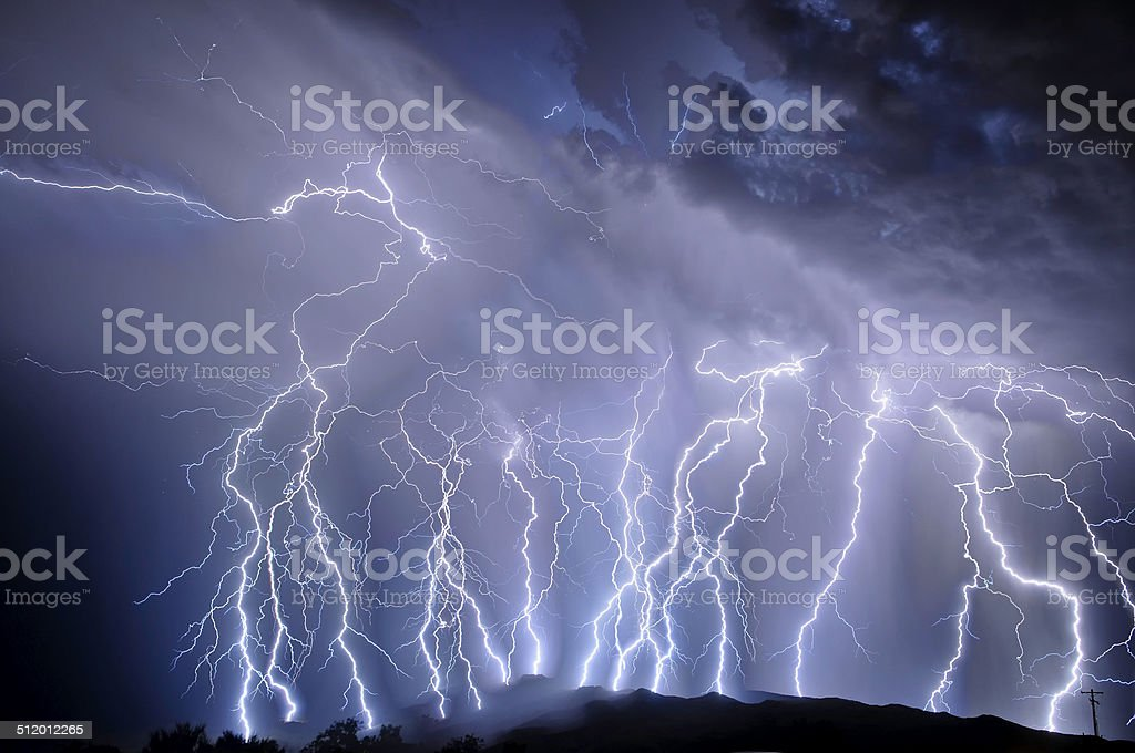 Lightning over the Rincon Mountains stock photo