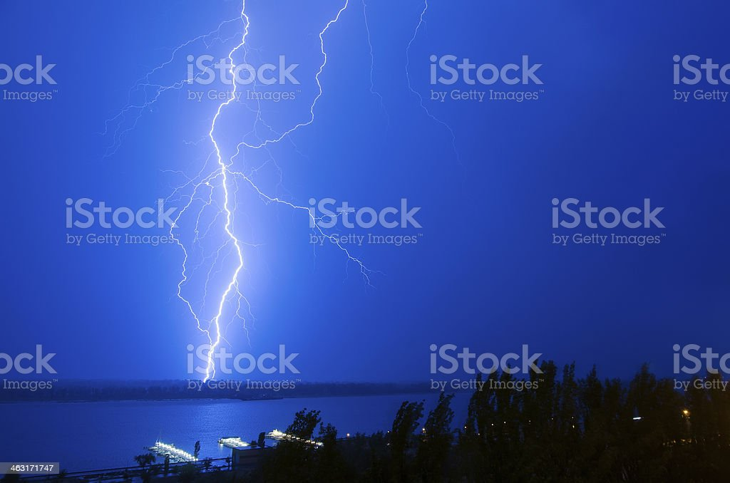 Lightning over the river stock photo