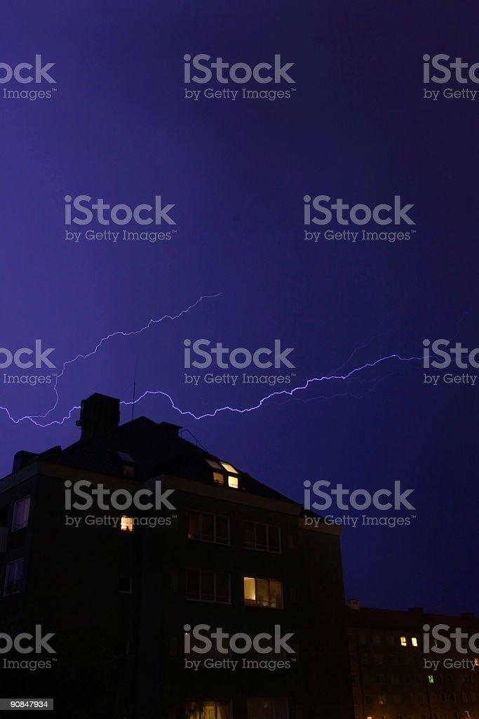 Lightning over urban housing area stock photo