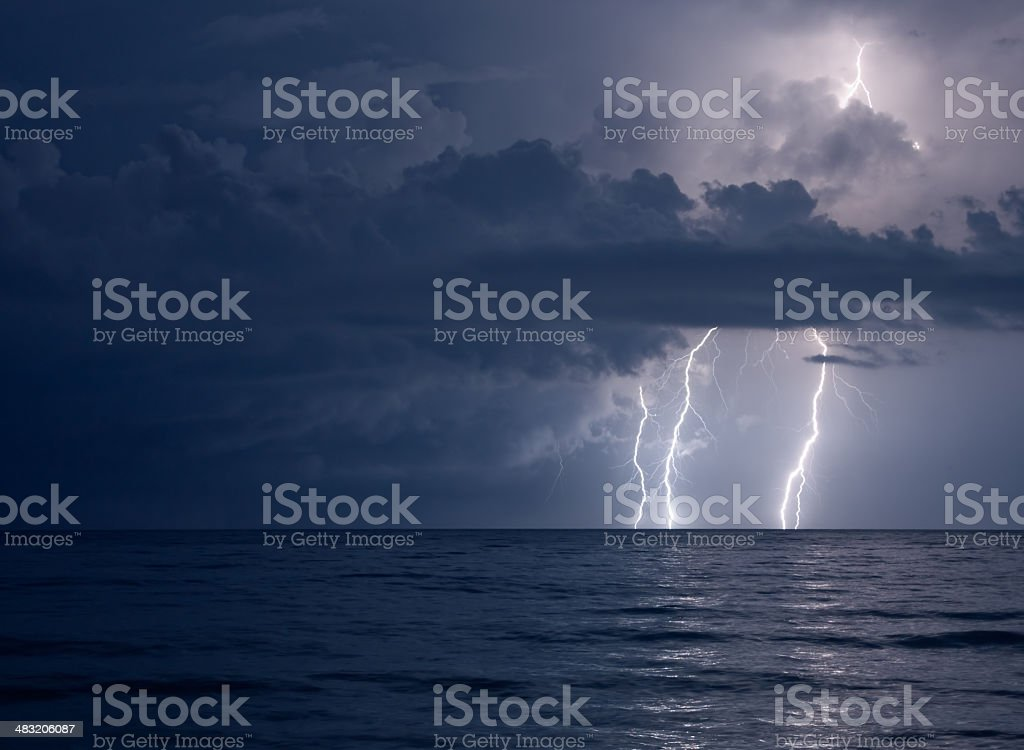 lightning over water royalty-free stock photo