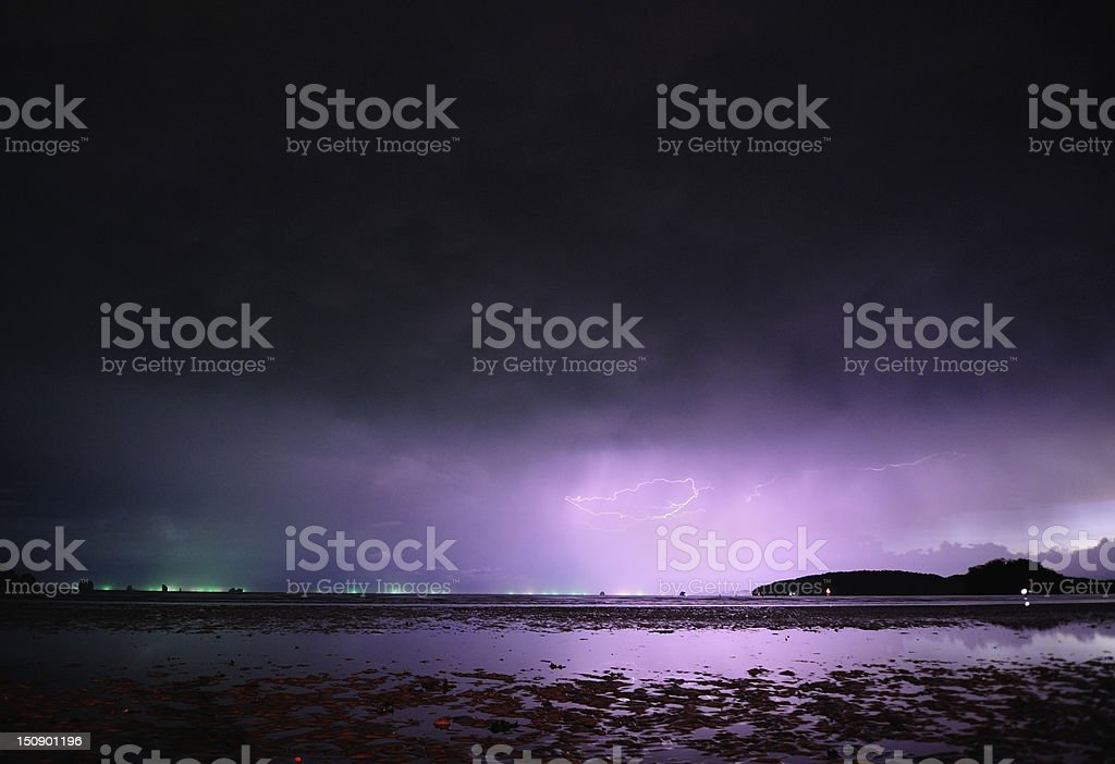 lightning reflecting in sea royalty-free stock photo