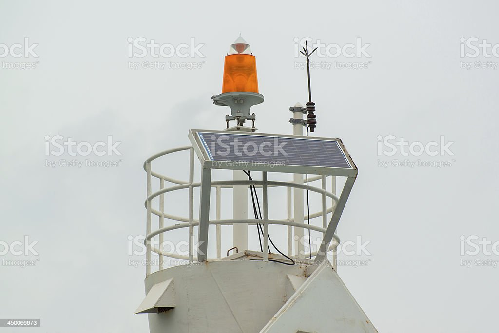 lightning rod and solar cell on the top of lighthouse royalty-free stock photo