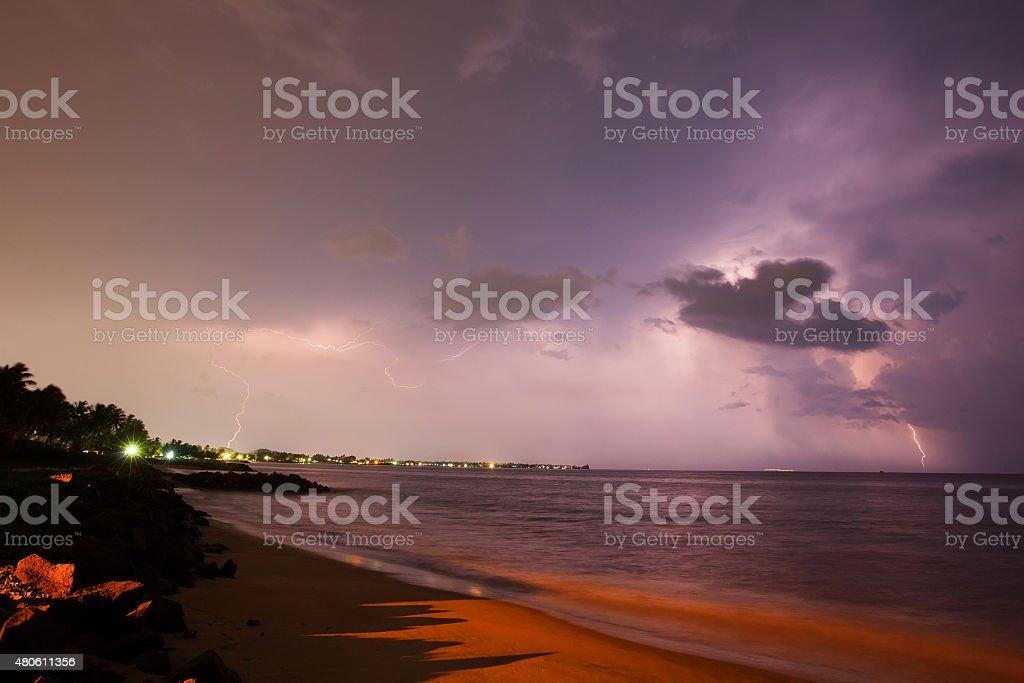 Lightning show above horizon at seashore of Sri Lanka stock photo