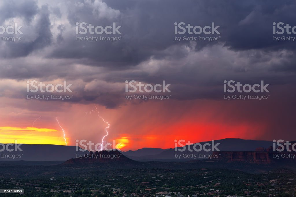 Lightning storm at sunset stock photo