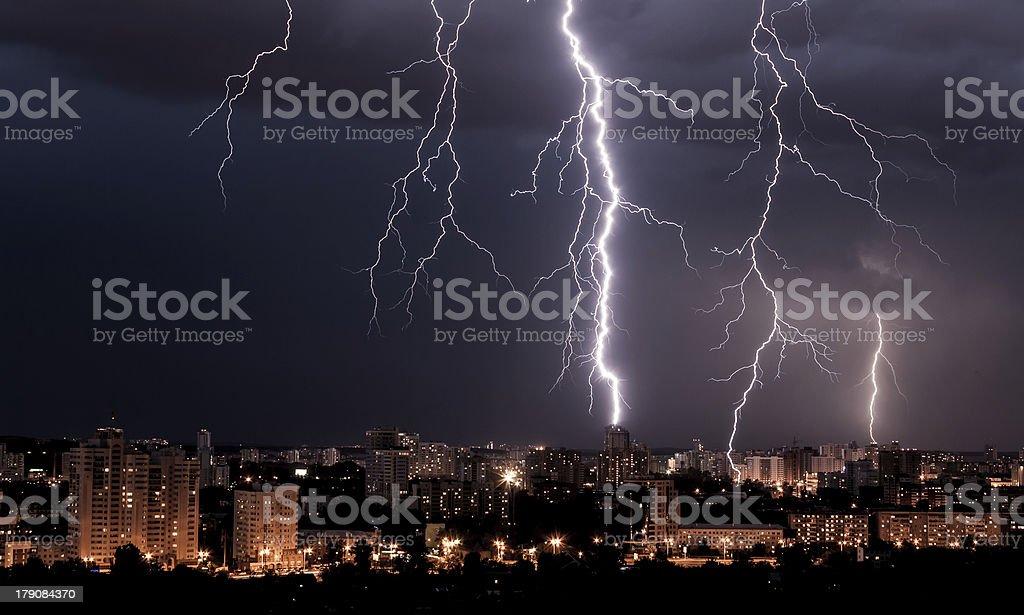 lightning storm over city stock photo