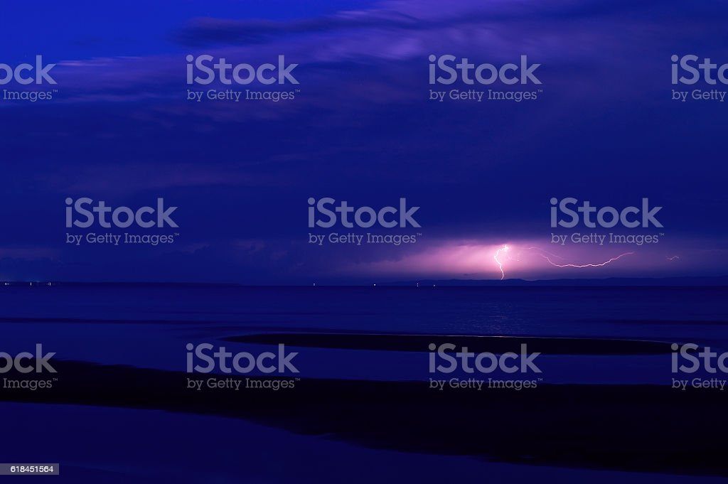 Lightning strike at night over Moreton Island in Queensland Australia stock photo
