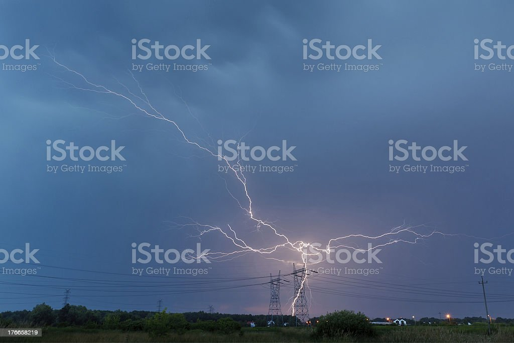 Lightning strike in electricity pole royalty-free stock photo
