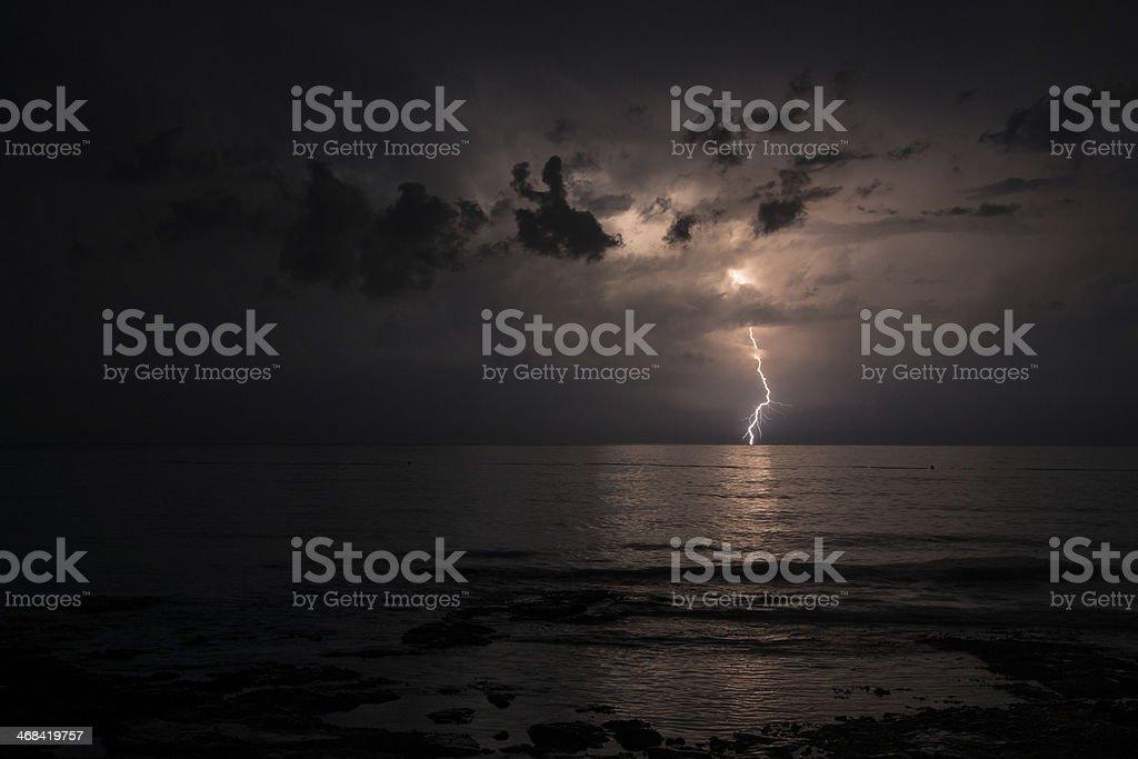 Lightning strike on a dark sky stock photo