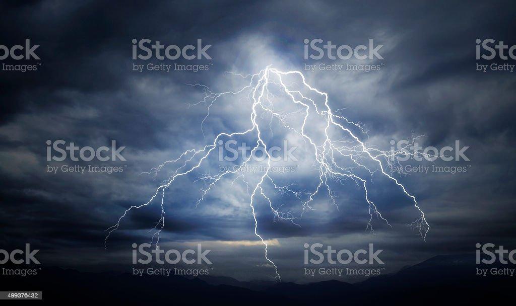 lightning strike on the cloudy sky stock photo