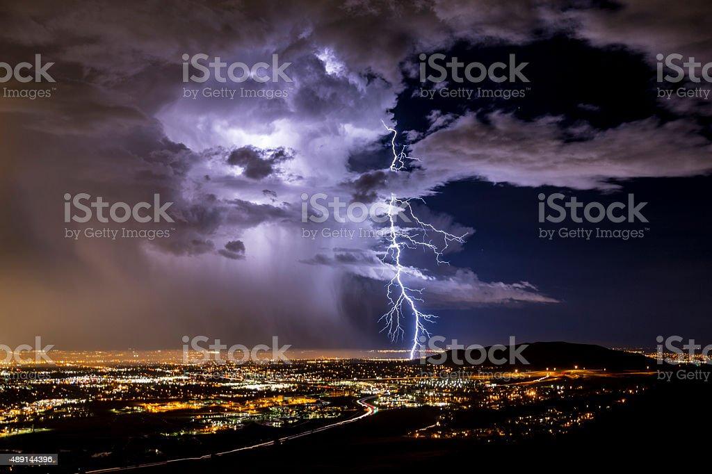 Lightning strike over a city stock photo