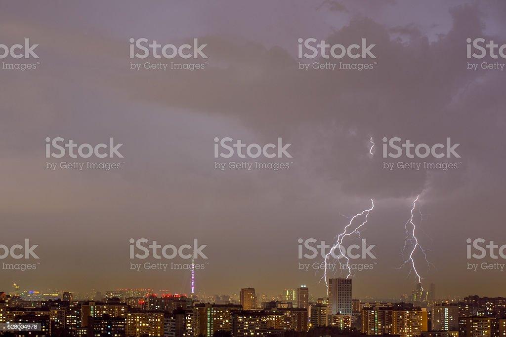 Lightning strike over city. stock photo