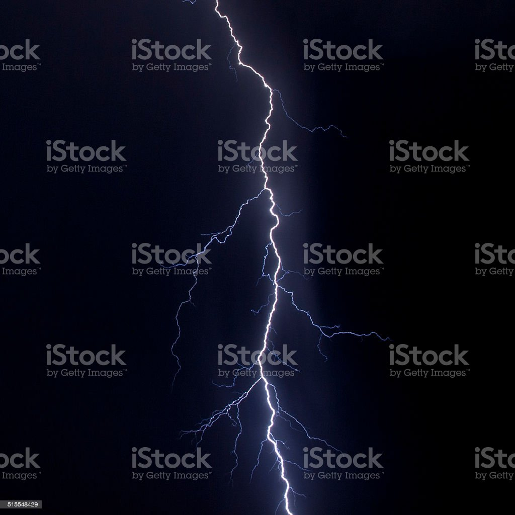 Lightning strike over night city stock photo