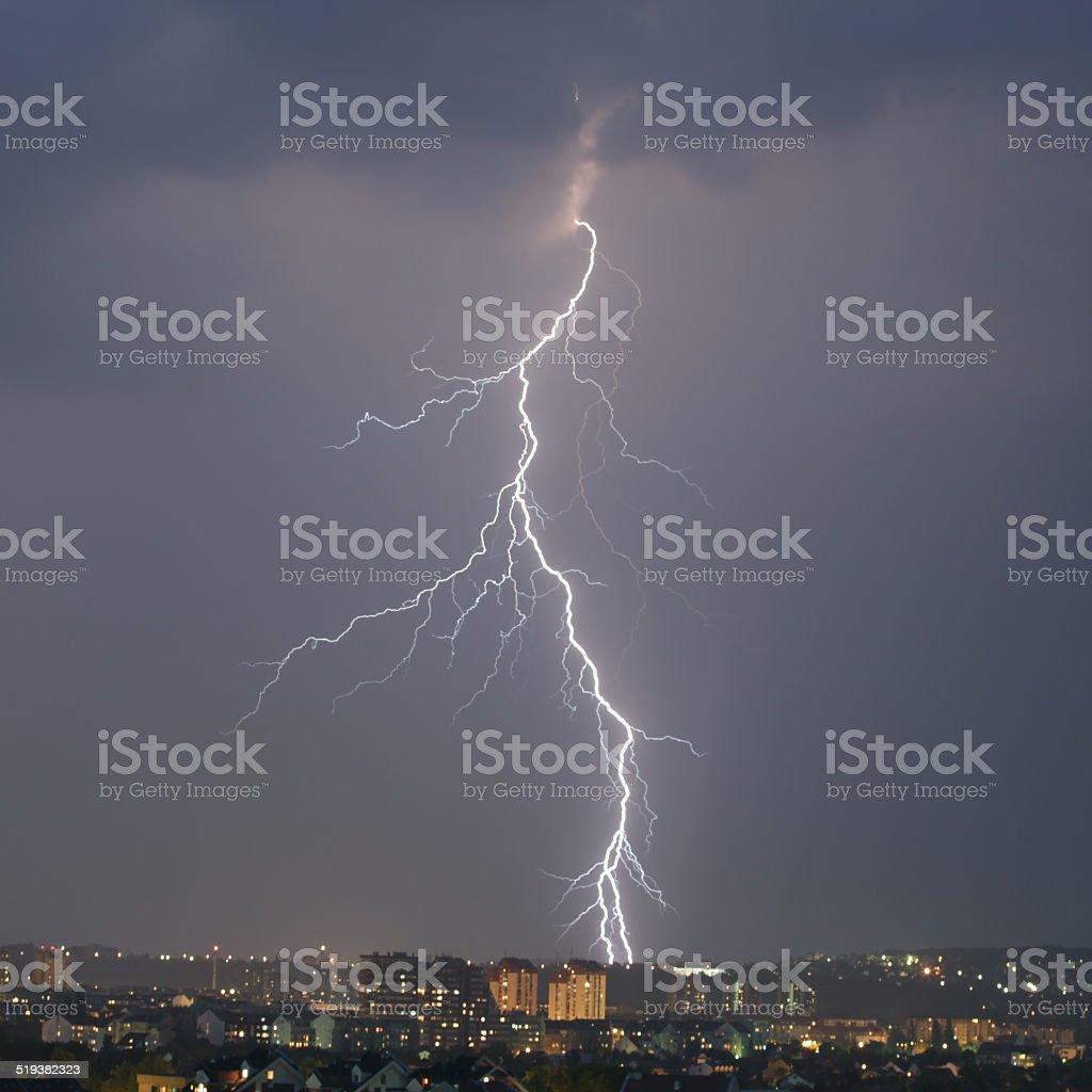 Lightning strike over night city stock photo