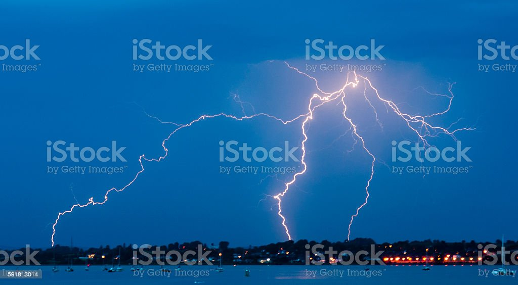 Lightning strike over Topsham and Exeter at night stock photo