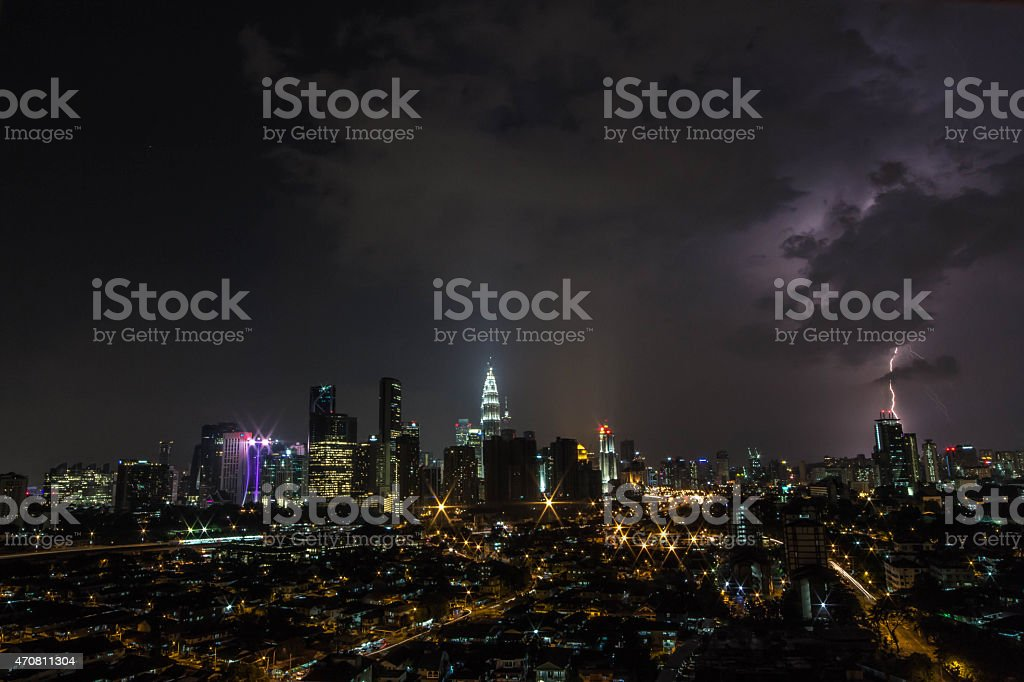 Lightning strikes a building in Kuala Lumpur during a storm royalty-free stock photo