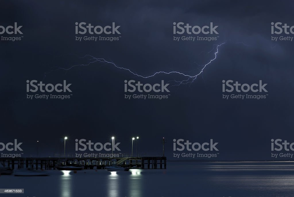 Lightning Strikes above a Pier stock photo