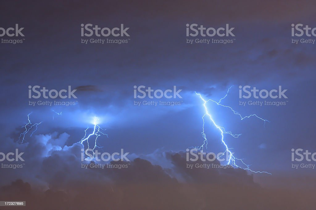 A lightning strikes from the sky during a thunderstorm stock photo