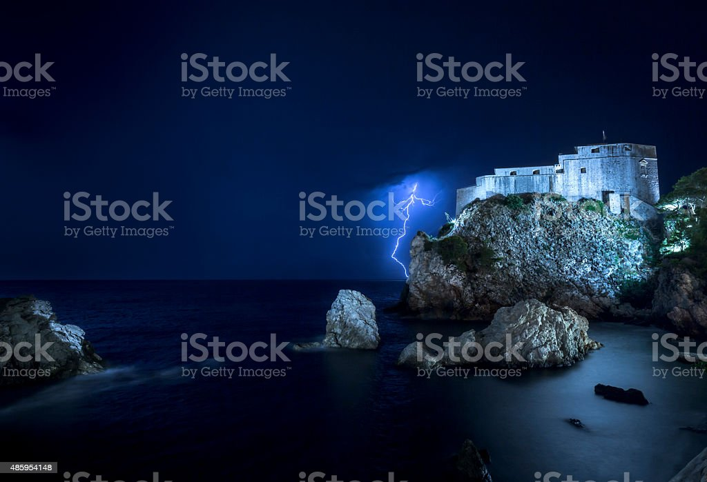 Lightning strikes in Dubrovnik, Croatia at night stock photo