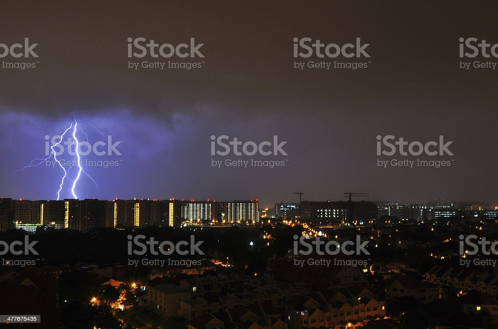 Lightning Strikes over an estate in Singapore royalty-free stock photo