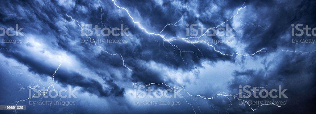 Lightning thunder bolt in dark thundercloud stock photo
