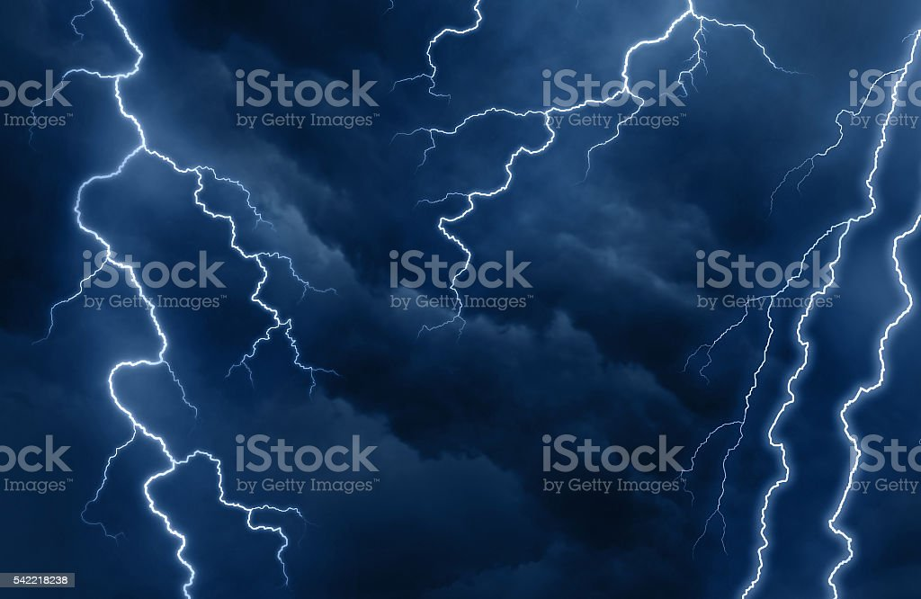 Lightnings and bright sparks glow in the sky during thunderstorm stock photo