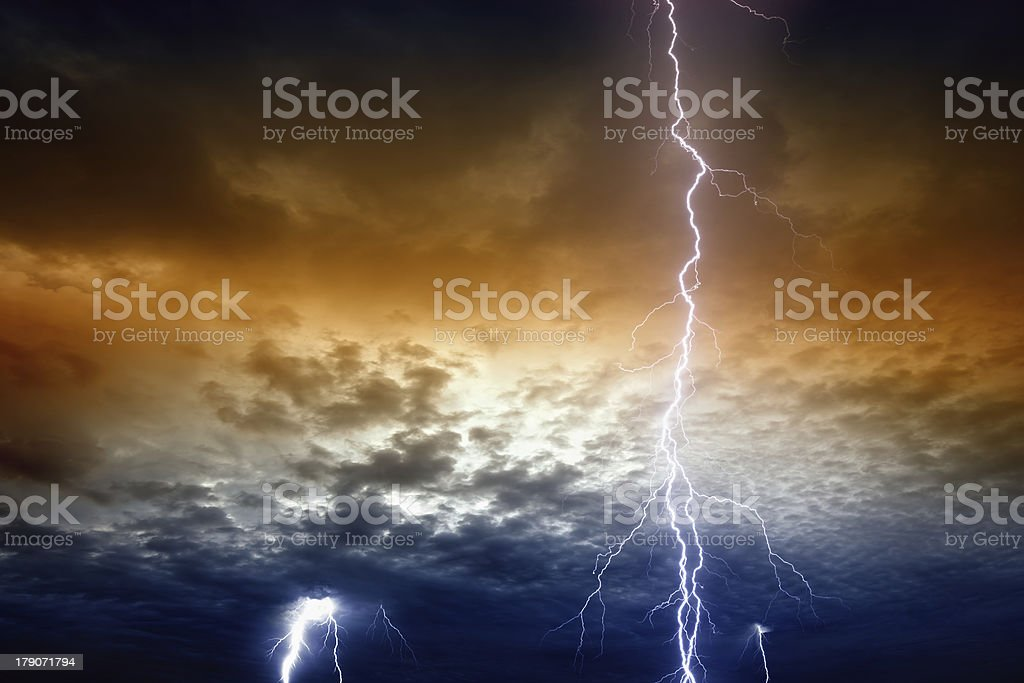 Lightnings in stormy sunset sky royalty-free stock photo