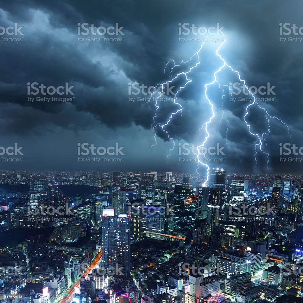 Lightnings over city skyscrapers during thunderstorm stock photo