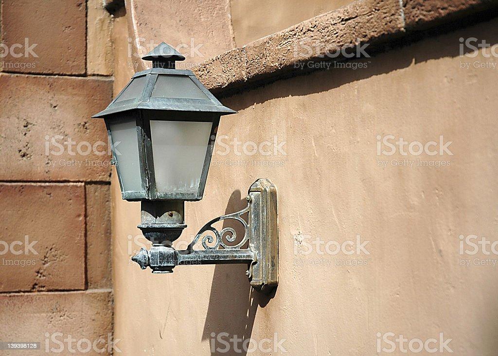 Lightpost in wall stock photo