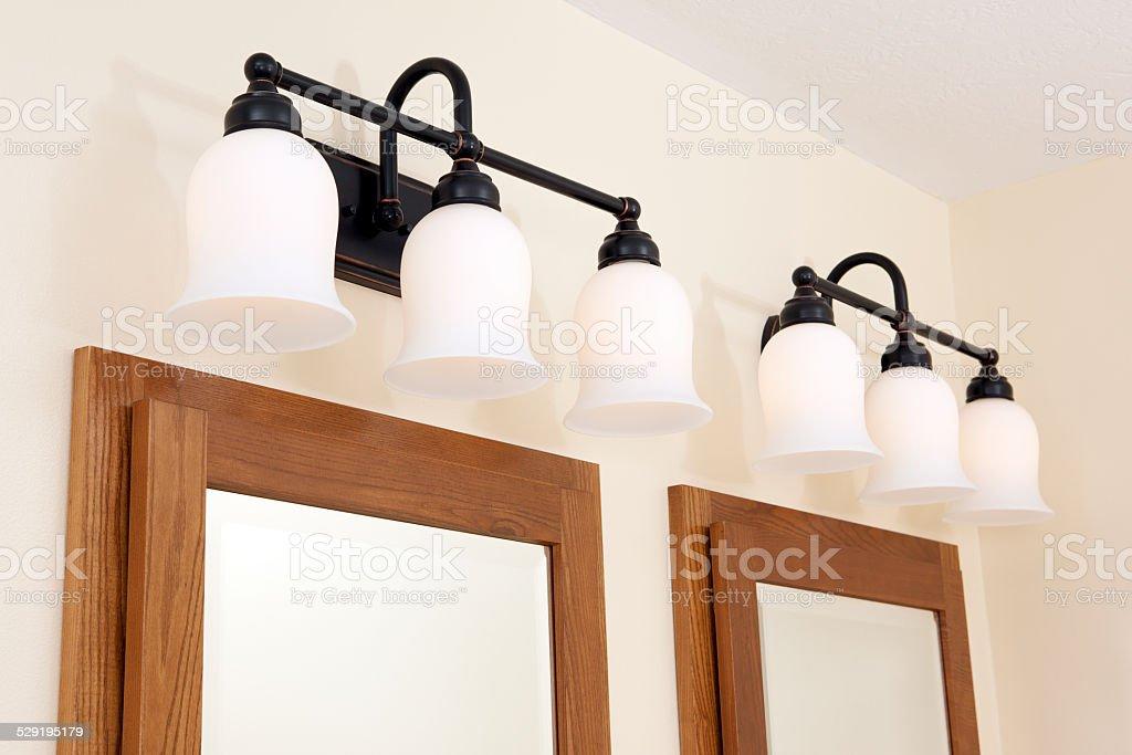 Lights above bathroom medicine cabinet mirror stock photo