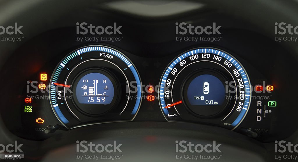 Lights and icons on dashboard of hybrid car stock photo