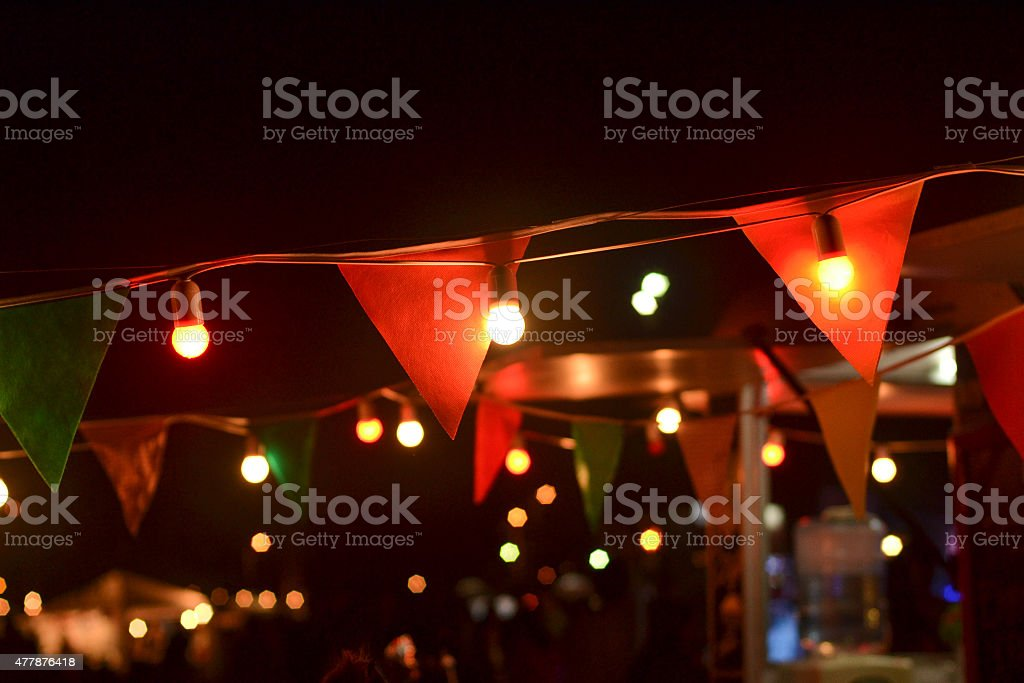 Lights and pennants at night stock photo