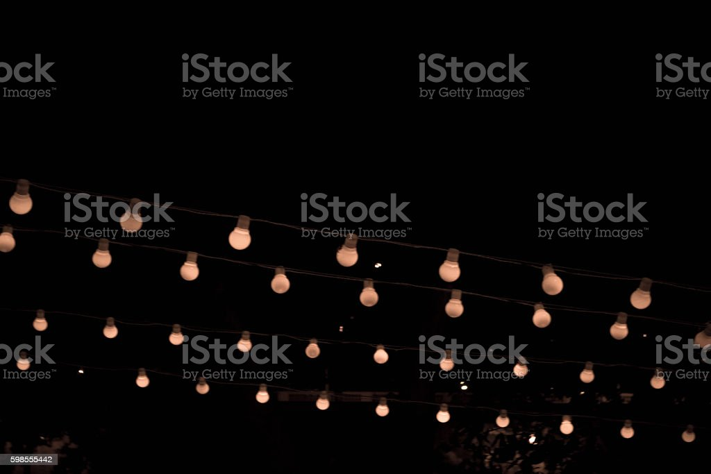 Lights bulbs at night stock photo