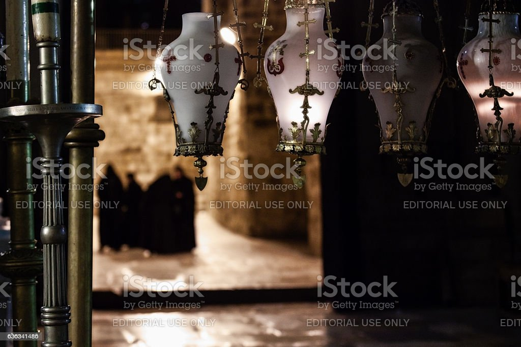 Lights by the entrance to the Church of Holy Sepulchre stock photo