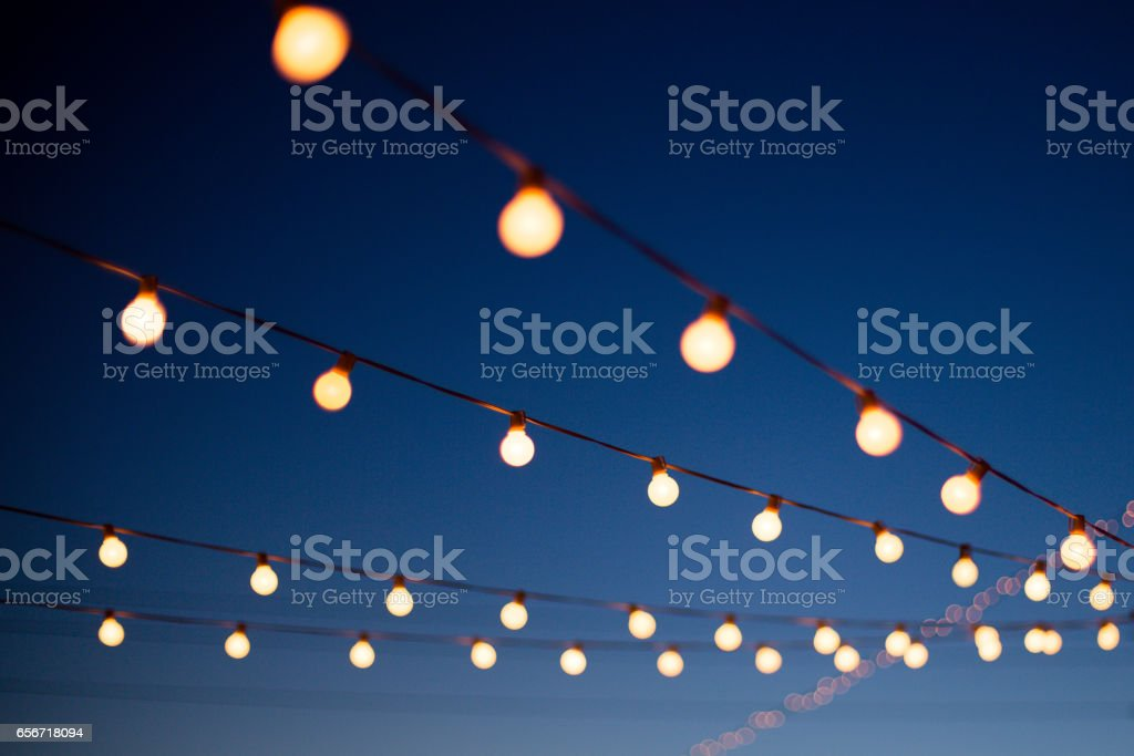 Lights hang outdoors stock photo