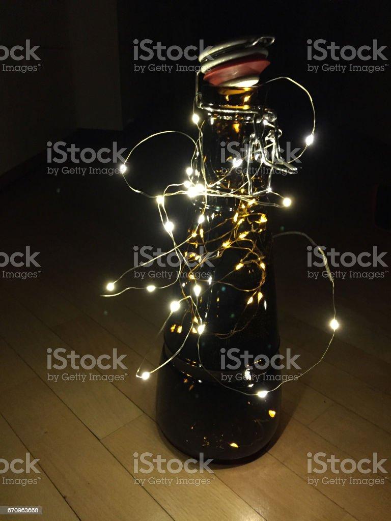 lights in bottle, christmas light decor stock photo