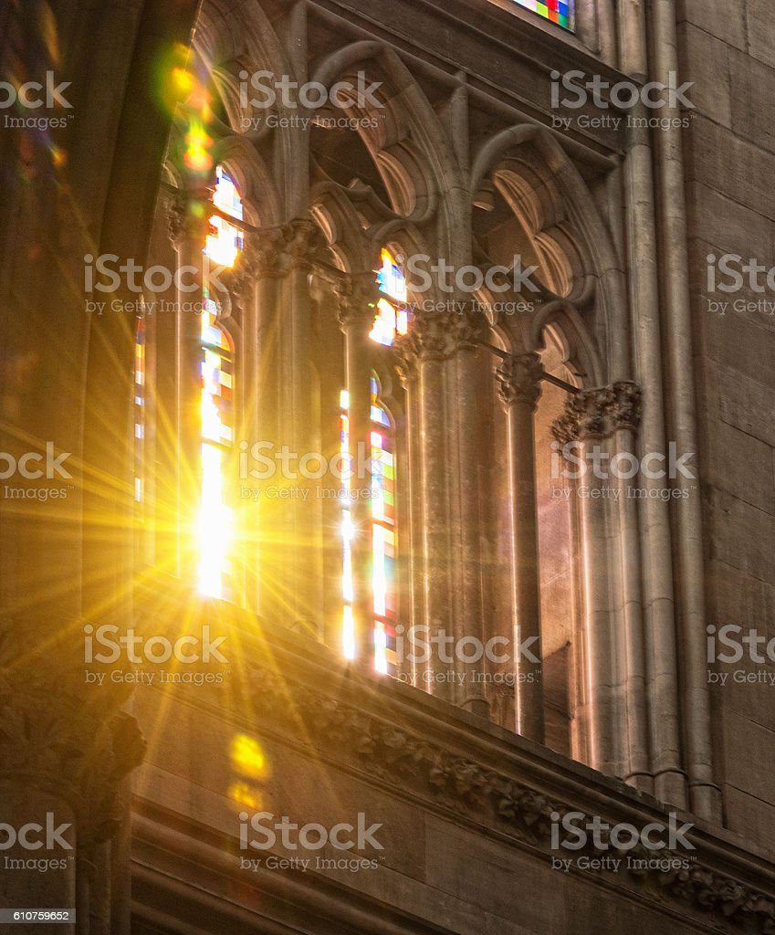 lights of love - sunbeam in a church window stock photo